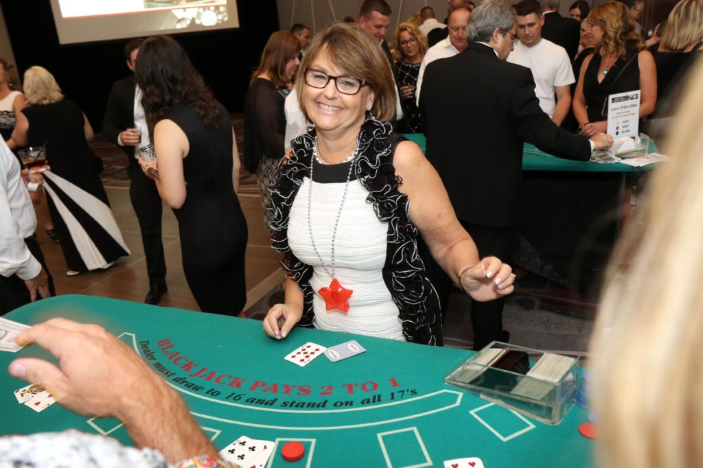 RASM member poses as a casino game dealer at the 2018 Casino Night event.