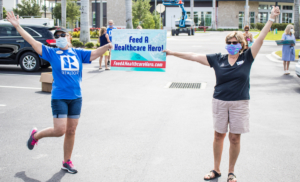 realtors holding Feed a Healthcare hero sign